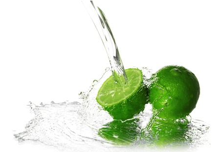 Water splash on lime isolated on white photo