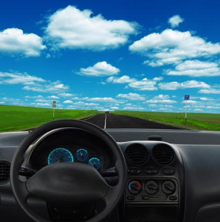 Inside car view at high speed, road sky grass Stock Photo - 9825339