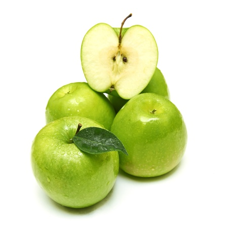 Green apple fruits and half of apple and green leaves isolated on white background photo