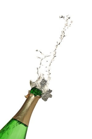 Bottle of champagne with splashes over white background photo