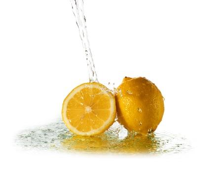 Water splash on lemon isolated on white photo