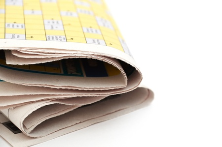 rolled up newspaper isolated on white background photo
