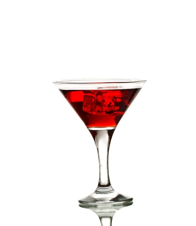 Red martini cocktail with ice cubes isolated on white photo