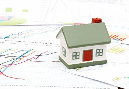 economic downturn: Housing market concept image with graph on chart background Stock Photo