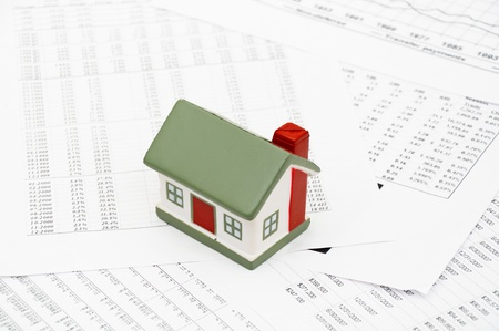 Housing market concept image with graph on chart background photo