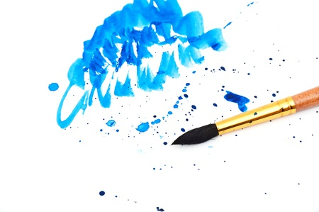 brush with blue paint stroke and stick, isolated on white photo