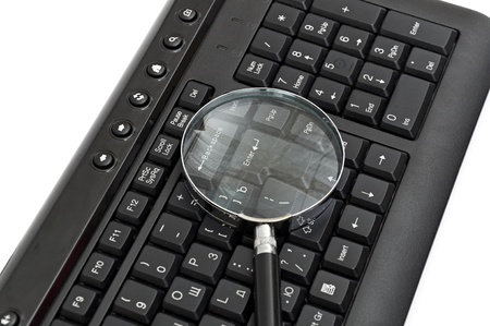 Online Search Concept. magnifying glass on keyboard photo