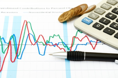 Calculator, coins and pen laying on chart. Concept of finance. Stock Photo - 10214010
