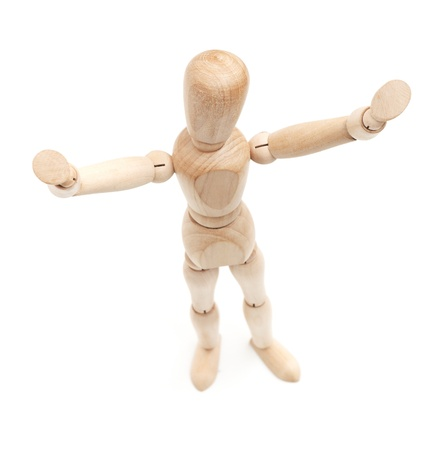 I surrender! Wooden figure with hands raised photo