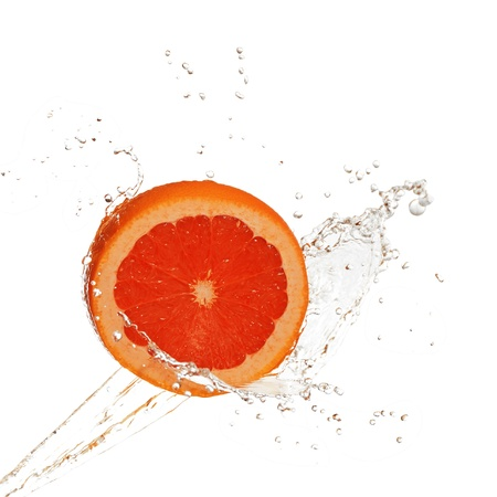 Water splash on grapefruit isolated on white Stock Photo