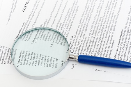 blue Magnifying Glass and document close up photo