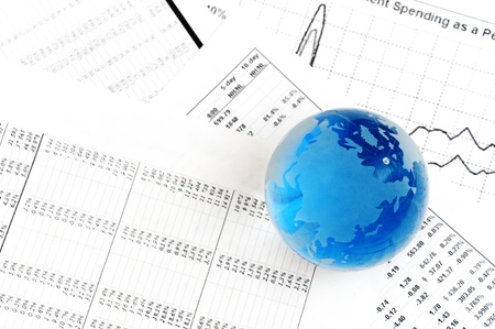 Crystal Ball on the financial section of a newspaper. photo