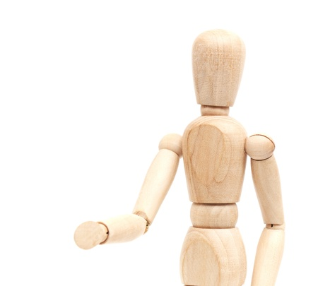 A wooden mannequin give a hand, greets. isolated on white photo