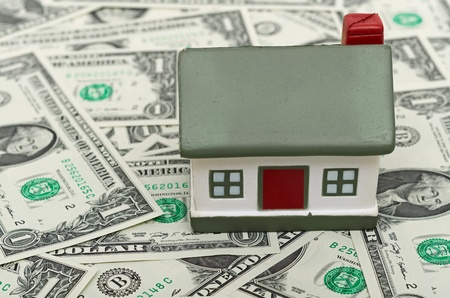 mini house on Us dollars, abstract background photo
