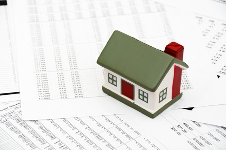 decline in values: Housing market concept image with graph on chart background Stock Photo