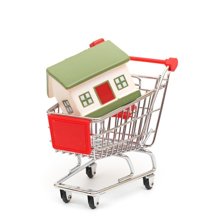 shopping cart trolley with house isolated on white Stock Photo - 10555989