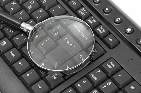 Magnifying glass, concept of on line security and investigation Stock Photo - 10556073