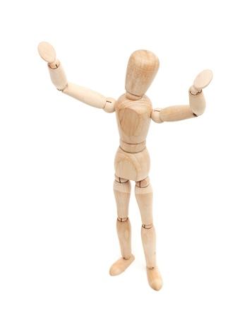 wooden figure: I surrender! Wooden figure with hands raised