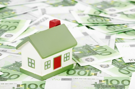 Cottage stands on the packs of euro Stock Photo - 12897749