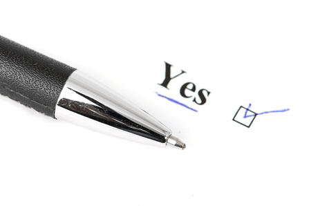 yes and pen isolated on a white background Stock Photo - 13913092