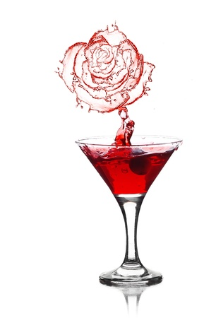 red rose splash from martini isolated on a white background Stock Photo - 13913031