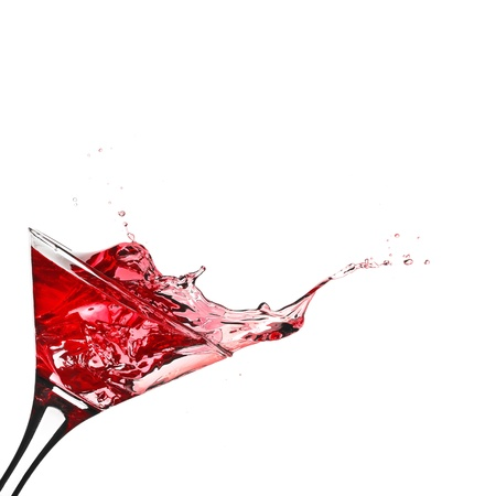 martini: Red cocktail with splash isolated on white