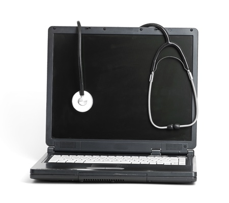 computer concept with stethoscope on laptop, shallow dof Stock Photo - 13913175
