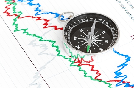 compass on the table and graph on a sheet of paper Stock Photo - 13913273