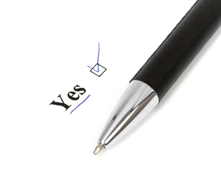 yes and pen isolated on a white background Stock Photo - 13913362