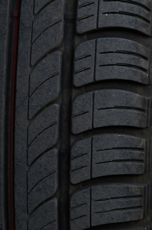 Car tire on a black background abstract photo