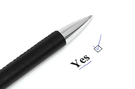 yes and pen isolated on a white background Stock Photo - 13982166