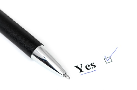 yes and pen isolated on a white background Stock Photo - 14058040