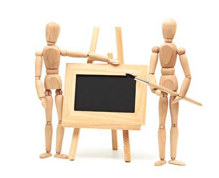 Wooden artist mannequin with brush in pose with wood frame Stock Photo - 14131895