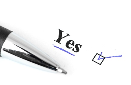 yes and pen isolated on a white background Stock Photo - 14131785