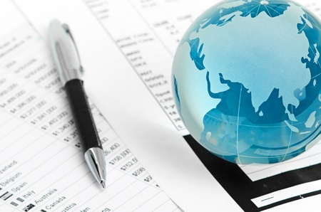 economic growth: Glass globe and pen on finance chart Stock Photo