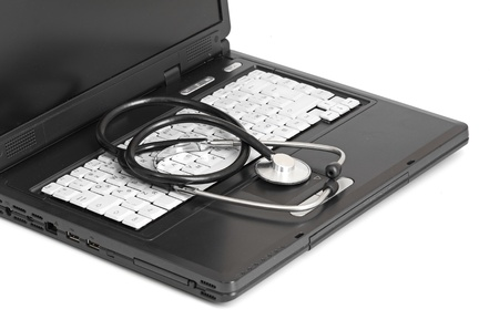 computer concept with stethoscope on laptop, shallow dof Stock Photo - 14241919