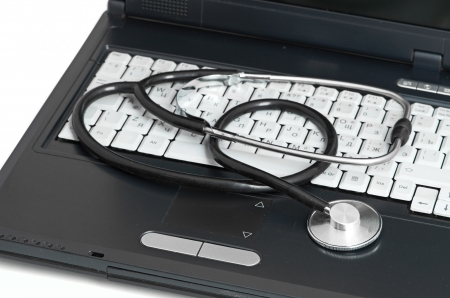 computer concept with stethoscope on laptop, shallow dof photo