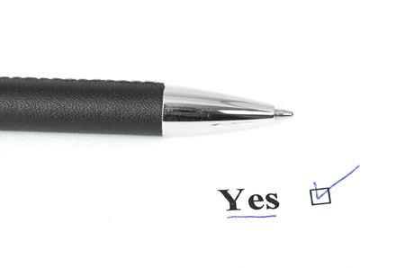 yes and pen isolated on a white background Stock Photo - 14672994