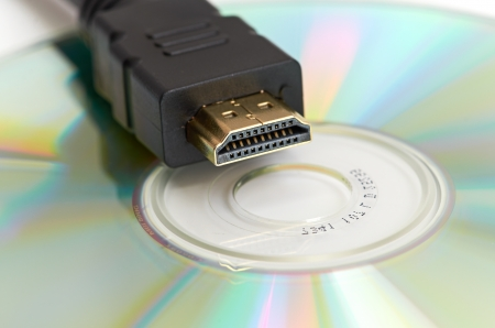 cd r: High Definition - HDMI Cable and Blank DVD Disc Stock Photo