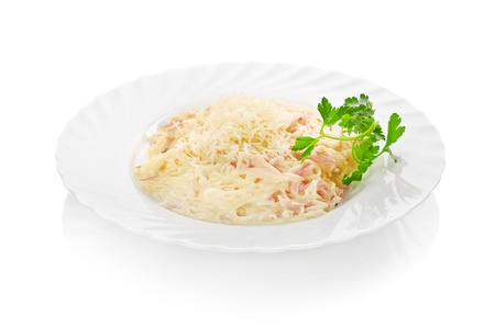 plate of pasta and smoked salmon isolated on white photo