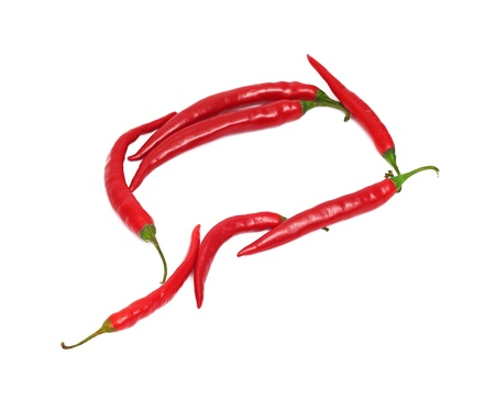 hot chilli peppers frame isolated on a white background photo