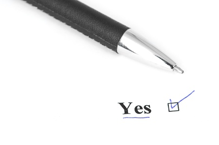 yes and pen isolated on a white background Stock Photo - 14790834