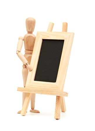 Wooden concept of mannequin in pose with wood frame Stock Photo - 14790926