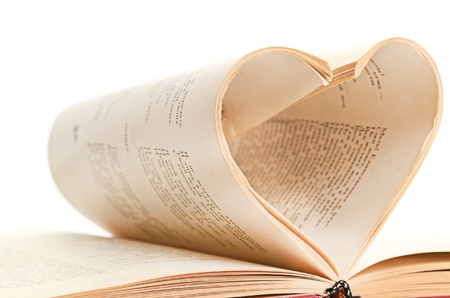 pages of a book curved into a heart isolated photo
