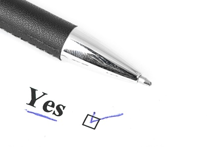 yes and pen isolated on a white background Stock Photo - 15188096