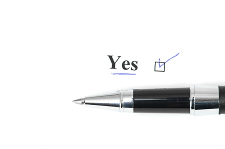 yes and pen isolated on a white background Stock Photo - 14947842
