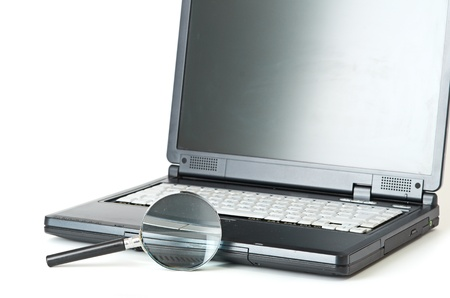 internet search: Laptop with a magnify glass isolated on white Stock Photo