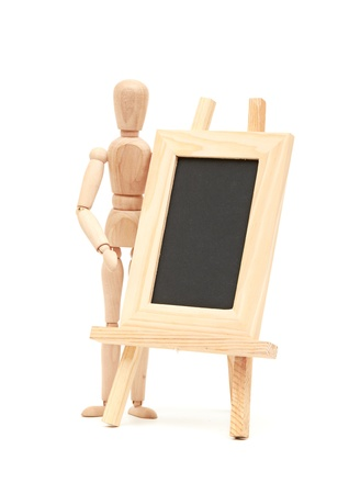 Wooden concept of mannequin in pose with wood frame photo