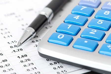 pen and calculator on business paper background photo