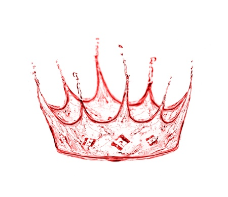crown made from wine splash isolated on white photo